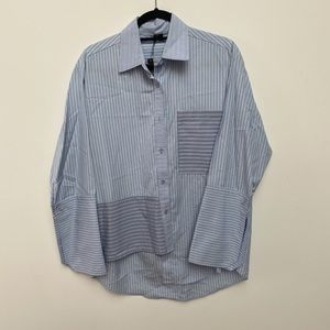Assymmetrical hem button down